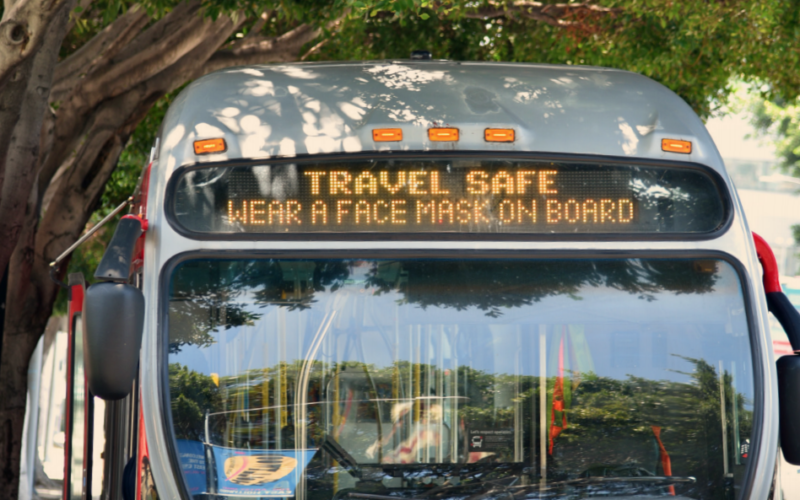 Rollsign on LA Metro bus reminds riders to wear a mask.